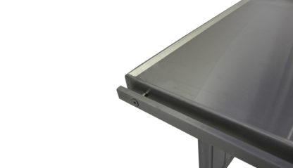 EnduraSteel™ Stainless Steel Two-Post Electric Lift Table detailed view of optional spill lip around perimeter of table