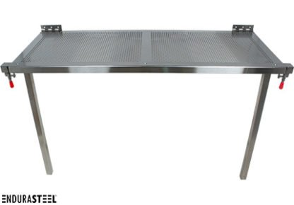 EnduraSteel™ Stainless Steel Folding Perforated Work Table with wall mounts shown set up, folded down, and ready for use