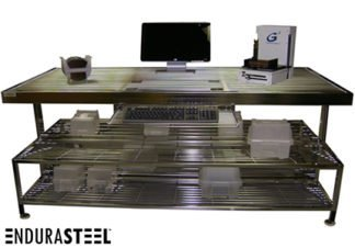 EnduraSteel™ Stainless Steel Rod Top Clean Room Work Table shown with EnduraSteel logo and various equipment on work and storage surfaces