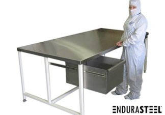 EnduraSteel™ Stainless Steel Clean Room Work Table shown with gowned clean room technician and optional drawer